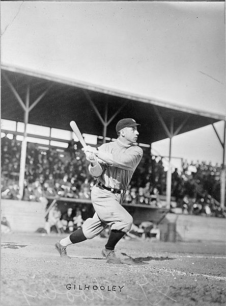 Frank Gilhooley, baseball player with the New York Yankees, swings his bat at home plate. Photo: Author Unknown via Wikimedia Commons