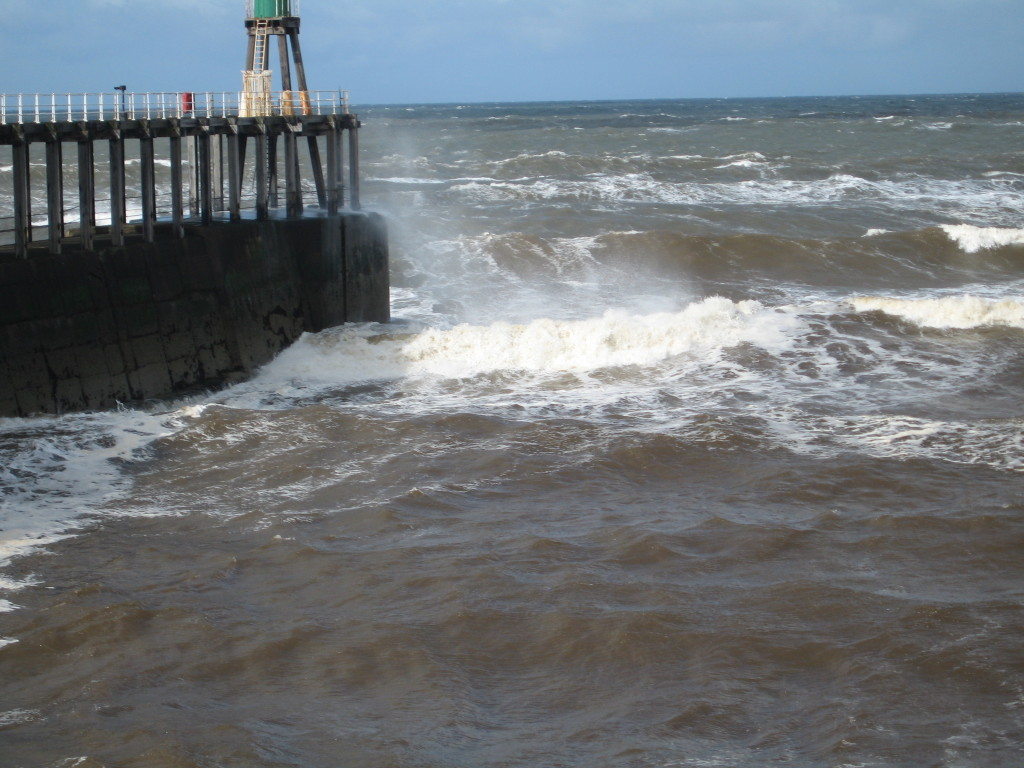 Waves crashing into the pier Photo credit: Cathy Hanson