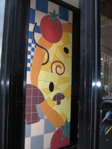 Mosaic at entrance to Pizza Hut in York, England. Photo Credit: Cathy Hanson
