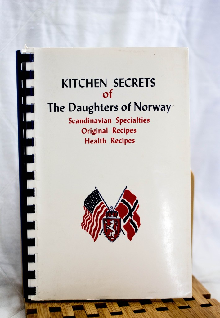 One of my mother's collected community cookbooks. Yes, we're from Norway. Photo Credit: Johnna Mathews, facebook.com/johnnamphotography
