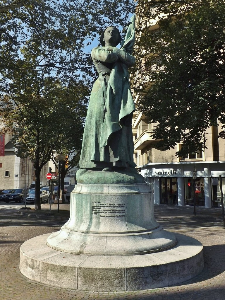 Sight, in the morning sun, of La Sasson statue (1892), in the city of Chambéry center, in Savoie, France. Author: Florian Pépellin