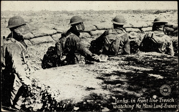 1919 postcard image of World War I U.S. troops in front-line trench, wearing French-made M2 gas masks. Chicago Daily News