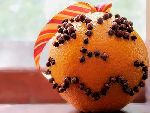 Orange pomander studded with cloves. Photo: Wendy Piersall