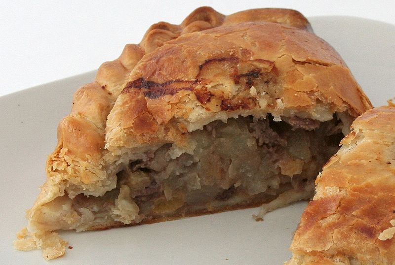 A Cornish pasty made by Warrens cut in half. The filling is beef steak, potato, turnip and onion. Photo: David Johnson via Wikimedia Commons