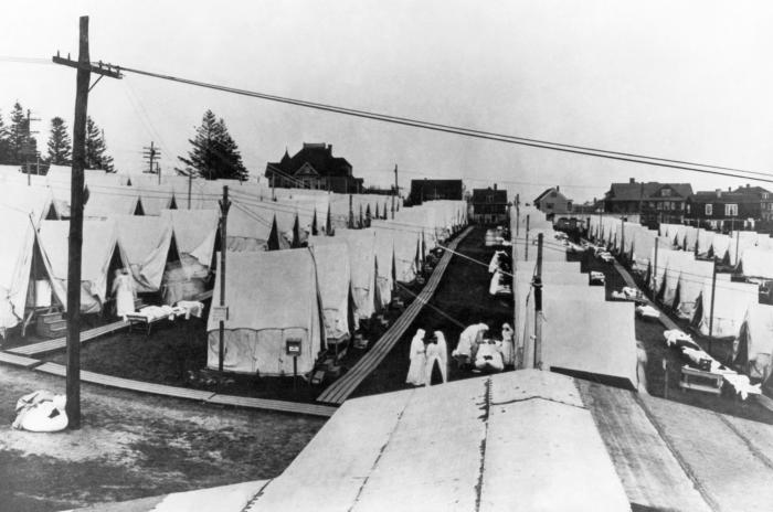 This May 29, 1919 photograph showed rows of tents that had been set up on a lawn at Emery Hill in Lawrence, Massachusetts where victims of the 1918 influenza pandemic were treated. Photo from Wikimedia Commons