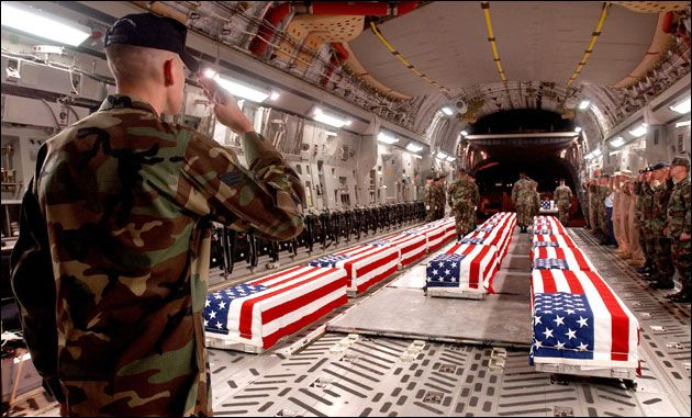 US war casualties in a C-17 Globemaster III at Dover Air Force Base This photo and 361 others have been released by the Air Force due to a Freedom of Information Act request from The Memory Hole, and can also be found at this site. Photo via Wikimedia Commons
