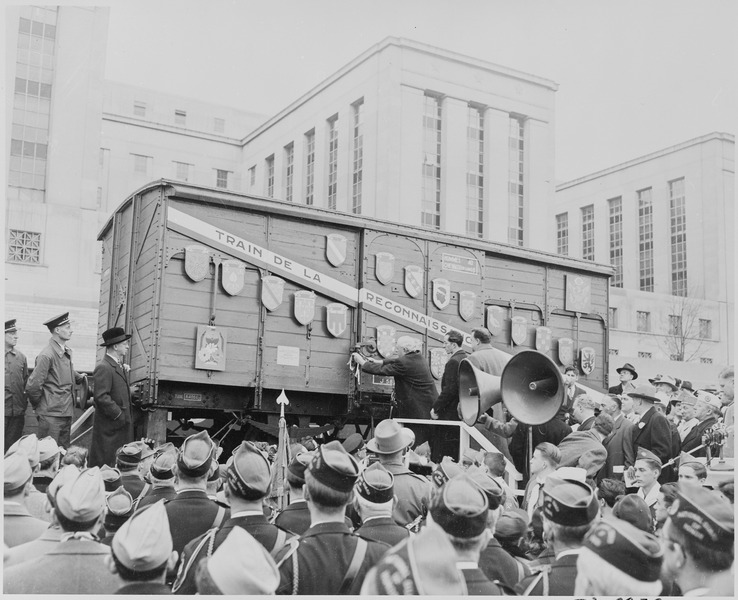 "Photograph of boxcar from French ""Merci train,"" a gift from France to the United States in grateful recognition of U.S. aid to France after World War II, during a ceremony. Photo from the Harry S. Truman Library via Wikimedia Commons"